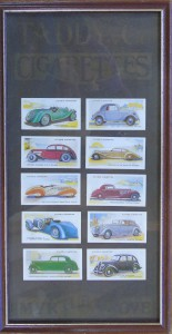 Framed set of cigarette cards, featuring cars including an Aston Martin 2 litre.