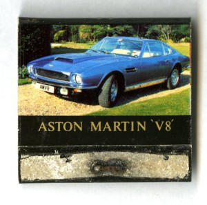 Book of matches, coloured black with a blue Aston Martin V8 photo.