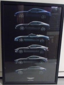 Framed poster of all the Aston Martin models from DB7 to the V8 Vantage