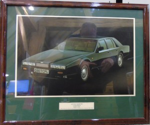 Framed photograph of an Aston Martin V8 Lagonda, part of the V8 Aston Martin Commemorative Collection, 1969-1990 (Hunter Green Collection).