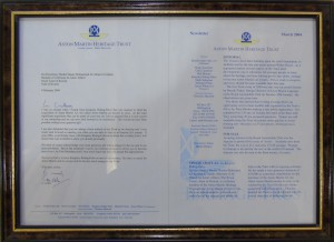 Framed letter from Gerald Acher to His Excellency Sheikh Nasser Mohammed Al-Ahmed Al-Sabah regarding sponsorship of the Aston Martin 'A3' restoration fund.