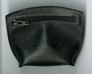 Black Leather Purse with Aston Martin logo on it