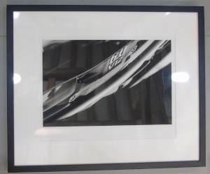 Framed photograph showing a close up of the lettering on an Aston Martin V12 Engine