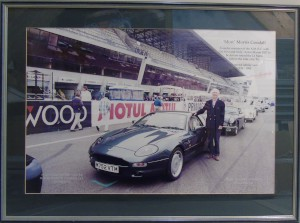 Large framed photograph of Mort Morris Goodall next to a DB7 at the start of the Le Mans 1995