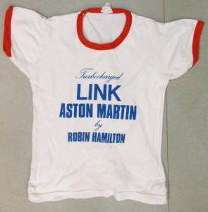 White T-Shirt with 'Turbocharged Link Aston Martin by Robin Hamilton' on front