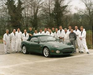 Press Photograph of an Aston Martin DB7 Vantage Volante with the Bloxham paint shop team