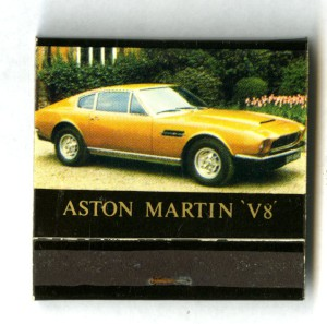 Book of match, black with a yellow Aston Martin V8