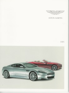 Spanish soft cover sales brochure for Aston Martin DBS Coupe and DBS Volante, plus accessories.